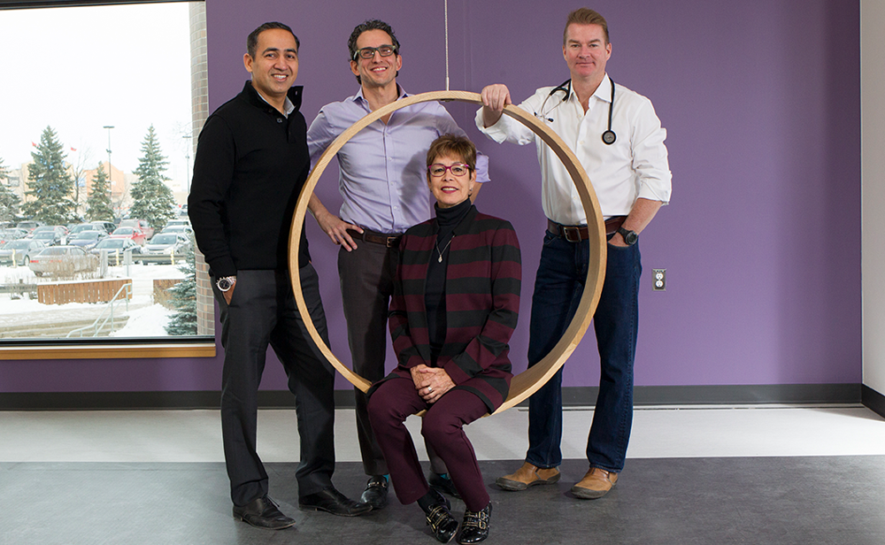 Photo of Drs. navdeep Tangri, Claudio Rigatto and Sean Armstrong with patient Cathy Woods
