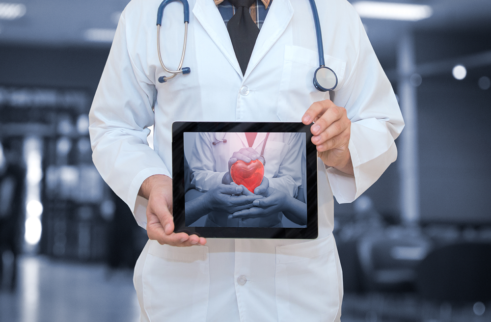 Photo of a doctor holding a tablet