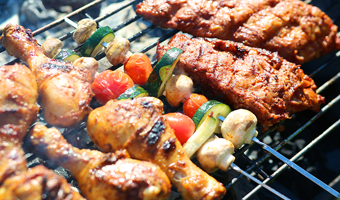 Photo of a barbecue grill with food