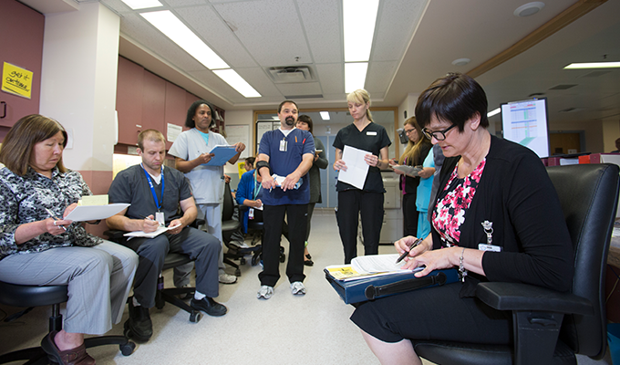 Members of a collaborative care team at Concordia Hospital gather for a Daily Action Round