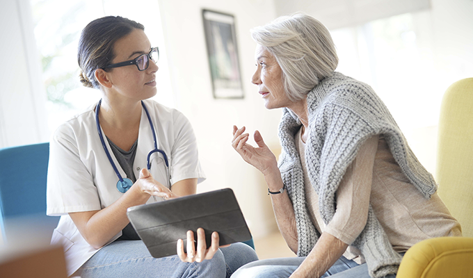 Photo of an elderly woman speaking with a doctor